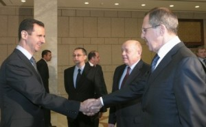 Syrian President Bashar al-Assad (L), shakes hands with Russian Foreign Minister Sergey Lavrov (R), as Russian Foreign Intelligence chief Mikhail Fradkov (2nd R) looks on during their meeting in Damascus February 7, 2012.  Lavrov began talks with Assad on Tuesday by saying Moscow wants Arab peoples to live in peace and the Syrian leader is aware of his responsibility, Russian news agency RIA reported.  REUTERS/Pool (SYRIA - Tags: POLITICS)