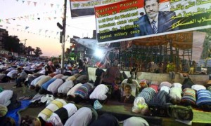 Muslim Brotherhood members pray during a Cairo protest in support of ousted president Mohamed Morsi