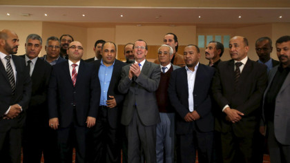 United Nations Special Representative and Head of the U.N. Support Mission in Libya Martin Kobler (C) poses with representatives of Libyan municipalities after their meeting in Tunis, Tunisia, December 21, 2015. REUTERS/Zoubeir Souissi